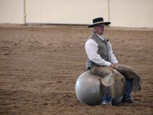 "Chris demostrating some of the ""Core Balance"" excersises, during a cow clinic at The Paws Up Ranch and Resort."
